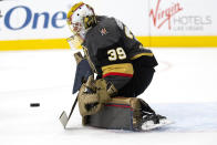 Vegas Golden Knights goaltender Laurent Brossoit (39) saves a shot on goal by the Colorado Avalanche during the first period of a preseason NHL hockey game at T-Mobile Arena on Tuesday, Sept. 28, 2021, in Las Vegas. (Ellen Schmidt/Las Vegas Review-Journal via AP)