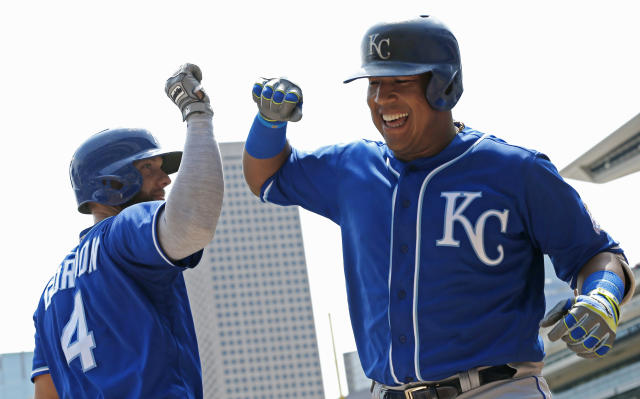 Kansas City Royals' Salvador Perez, right, celebrates his three-run home run off Minnesota Twins pitcher Lance Lynn with Alex Gordon in the first inning of a baseball game Wednesday, July 11, 2018, in Minneapolis. (AP Photo/Jim Mone)