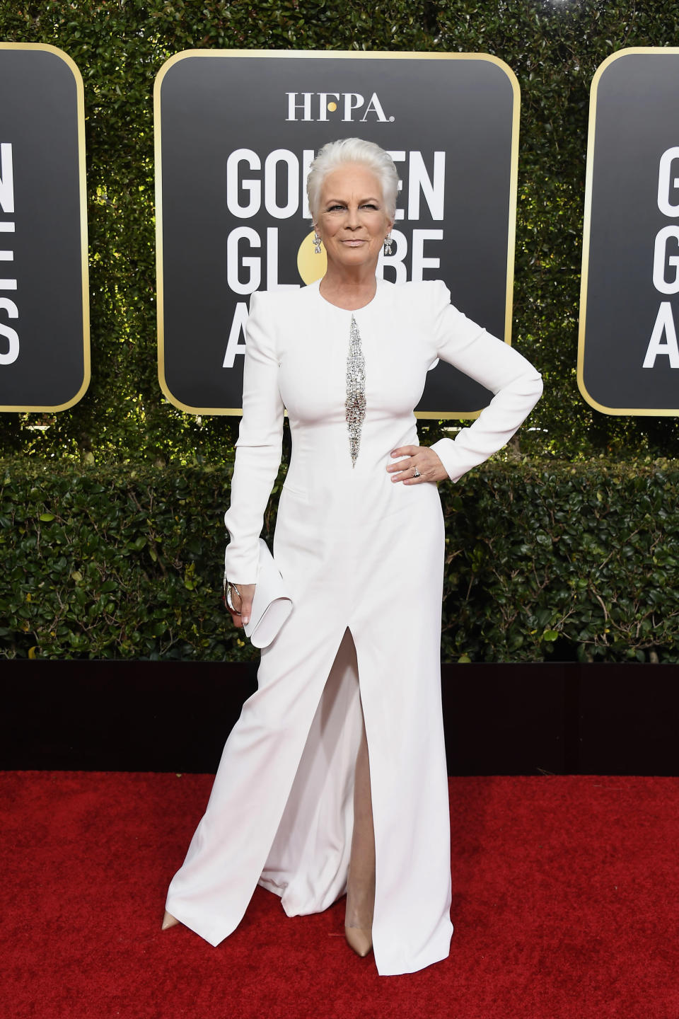 <p>Sexy at 60! Curtis looked radiant in a white Alexander McQueen gown.<br>Image via Getty Images. </p>