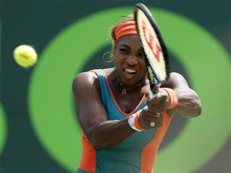 Mar 27, 2014; Miami, FL, USA; Serena Williams hits a backhand against Maria Sharapova (not pictured) on day eleven of the Sony Open at Crandon Tennis Center. Geoff Burke-USA TODAY Sports