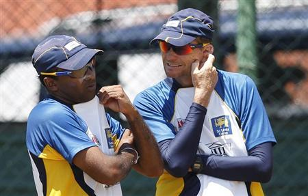 Sri Lanka's captain Mahela Jayawardene (L) talks with coach Graham Ford during a practice session ahead of their Twenty20 World Cup final match against West Indies in Colombo October 6, 2012. REUTERS/Dinuka Liyanawatte