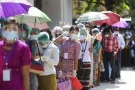 Voters wearing protective face masks to help curb the spread of the coronavirus line up to cast their ballots at a polling station near Shwedagon pagoda Sunday, Nov. 8, 2020, in Yangon, Myanmar. Voting was underway in Myanmar's elections on Sunday, with the party of Nobel Peace Prize laureate Aung San Suu Kyi heavily favored to retain power it had wrestled from the powerful military five years ago. (AP Photo/Thein Zaw)