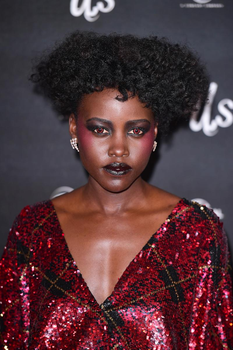 Lupita Nyong'o wearing red contacts at a screening of Us in London in March 2019.
