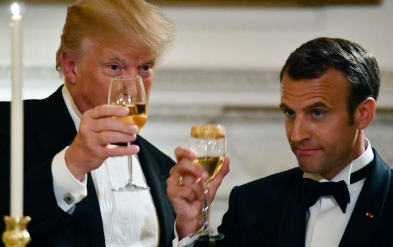 US President Donald Trump (L) and French President Emmanuel Macron (R) toast during a state dinner in honor of Macron at the White House on  April 24, 2018