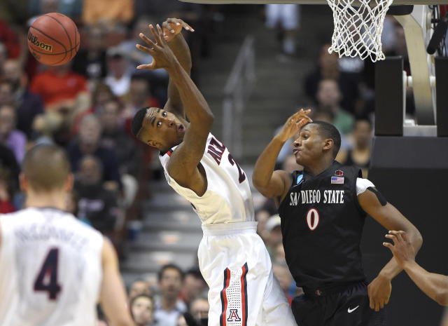 Arizona forward Rondae Hollis-Jefferson, center left, looks for the ball after San Diego State forward Skylar Spencer knocked it away during the second half of a regional semifinal in the NCAA men's college basketball tournament, Thursday, March 27, 2014, in Anaheim, Calif. (AP Photo/Mark J. Terrill)