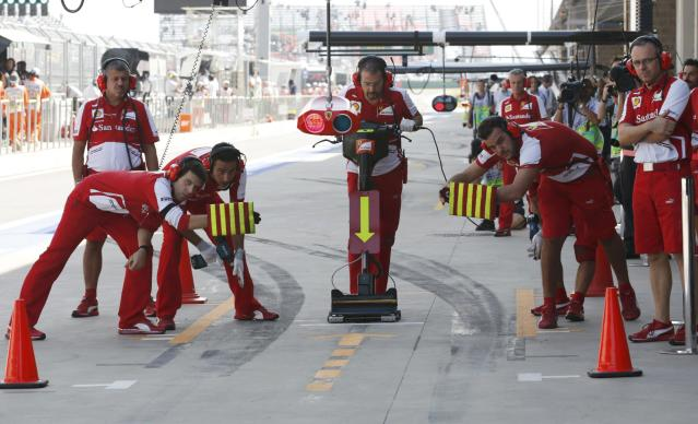 Pit crew wait for Ferrari Formula One driver Felipe Massa of Brazil during the third practice session of the Korean F1 Grand Prix at the Korea International Circuit in Yeongam, October 5, 2013. REUTERS/Lee Jae-Won (SOUTH KOREA - Tags: SPORT MOTORSPORT F1 TPX IMAGES OF THE DAY)