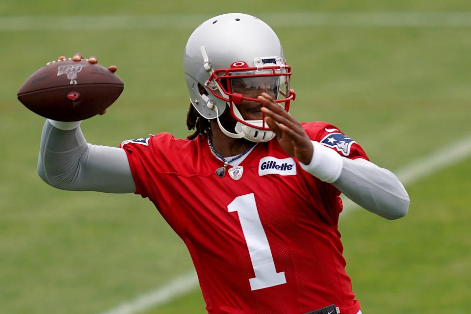 New England Patriots quarterback Cam Newton passes during a NFL football practice in Foxborough on June 4, 2021.