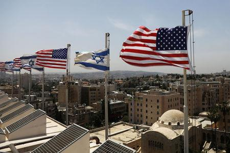 American and Israeli flags flutter in the wind atop the roof of the King David Hotel, in preparation for the upcoming visit of U.S. President Donald Trump to Israel, in Jerusalem