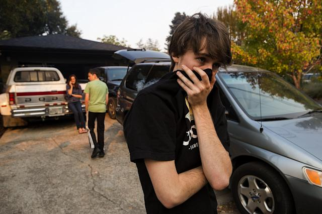 <p>Mason Heyman, 18, and his family defied a mandatory evacuation order issued on Wednesday, Oct. 11, 2017 in Calistoga, Calif. The nearby Tubbs Fire has destroyed hundreds of homes. (Photo: Paul Kitagaki Jr/Sacramento Bee via ZUMA Wire) </p>