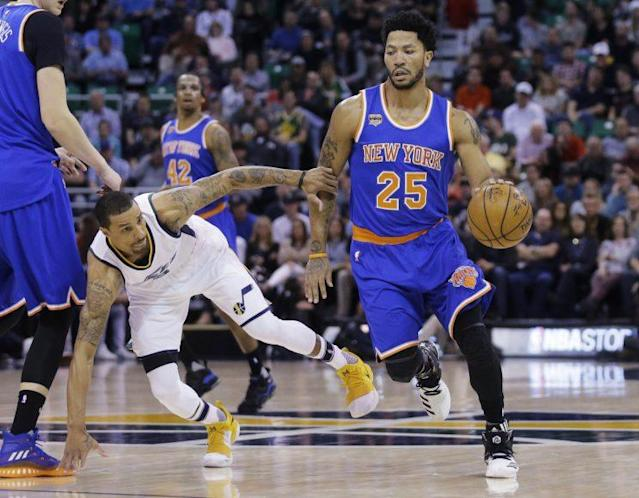 """<a class=""""link rapid-noclick-resp"""" href=""""/nba/players/4488/"""" data-ylk=""""slk:George Hill"""">George Hill</a> tries to keep up with <a class=""""link rapid-noclick-resp"""" href=""""/nba/players/4387/"""" data-ylk=""""slk:Derrick Rose"""">Derrick Rose</a>, or is it the other way around? (AP)"""