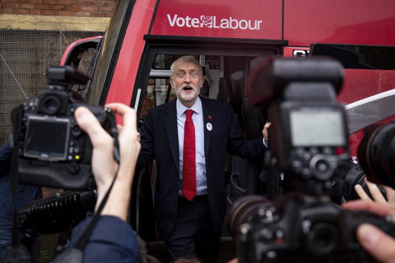 Britain's Labour Party leader Jeremy Corbyn unveils the Labour battle bus while on the general election campaign trail in Liverpool, England, Thursday Nov. 7, 2019. All 650 seats in the House of Commons are up for grabs in the Dec. 12 election, which is coming more than two years early. Some 46 million British voters are eligible to take part in the country's first December election in 96 years. (Jacob King/PA via AP)