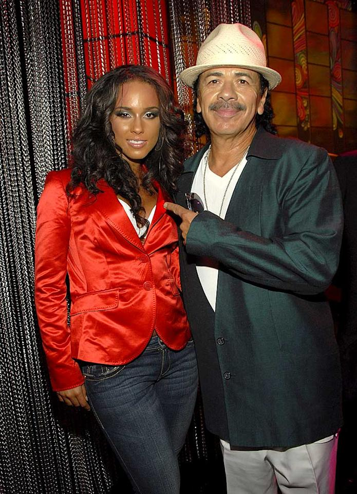 "Alicia Keys and Carlos Santana take a photo op before teaming up for their Fashion Rocks performance. Kevin Mazur/<a href=""http://www.wireimage.com"" target=""new"">WireImage.com</a> - September 6, 2007"
