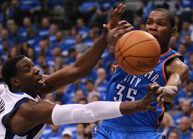 DALLAS, TX - MAY 03:  Kevin Durant #35 of the Oklahoma City Thunder passes the ball against Ian Mahinmi #28 of the Dallas Mavericks during Game Three of the Western Conference Quarterfinal at American Airlines Center on May 3, 2012 in Dallas, Texas.  NOTE TO USER: User expressly acknowledges and agrees that, by downloading and or using this photograph, User is consenting to the terms and conditions of the Getty Images License Agreement.  (Photo by Ronald Martinez/Getty Images)