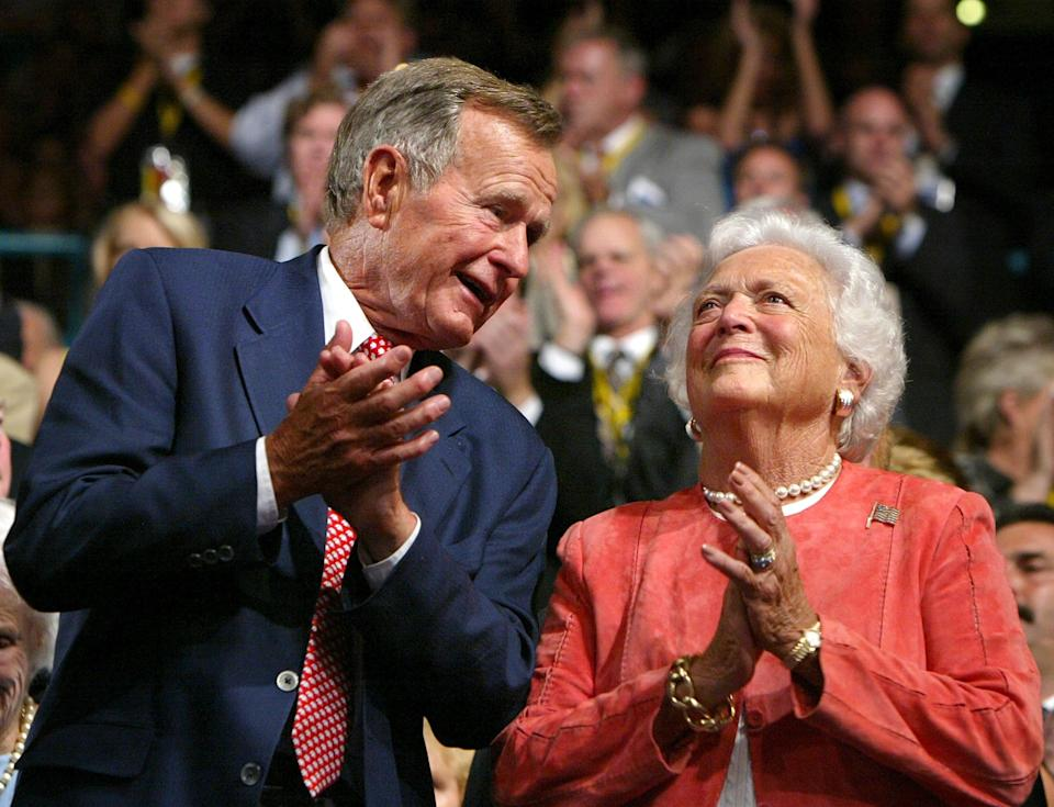 George and Barbara Bush applaud during the evening session of day one of the Republican National Convention on Aug. 30, 2004, at Madison Square Garden in New York.