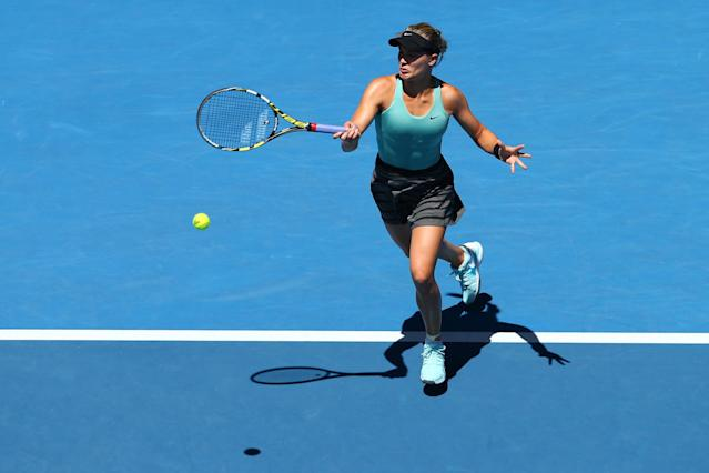 MELBOURNE, AUSTRALIA - JANUARY 21: Eugenie Bouchard of Canada plays a forehand in her quarterfinal match against Ana Ivanovic of Serbia during day nine of the 2014 Australian Open at Melbourne Park on January 21, 2014 in Melbourne, Australia. (Photo by Renee McKay/Getty Images)