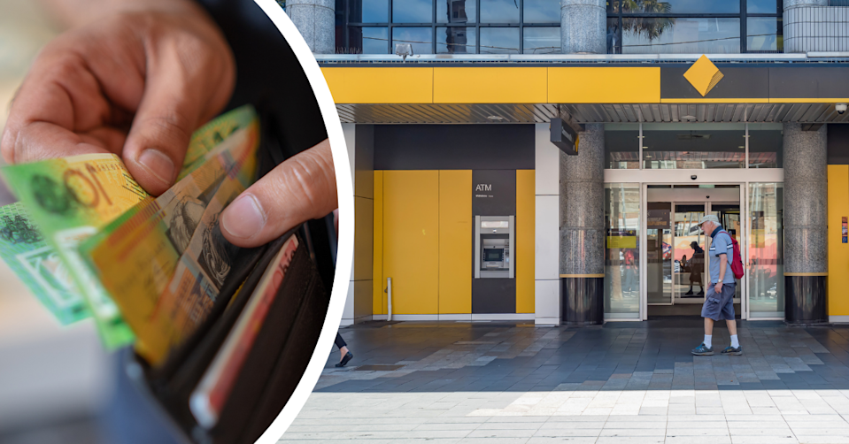A person removing $100 and $50 notes from a wallet and the exterior of a CBA branch