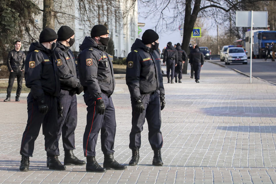 Police patrol a street to prevent a rally commemorating the founding of Belarus' 1918 proclamation of independence from Russia, in Minsk, Belarus, Thursday, March 25, 2021. Belarusian opposition have urged people to protest against repressions in the country and Lukashenko's regime. (BelaPan via AP)