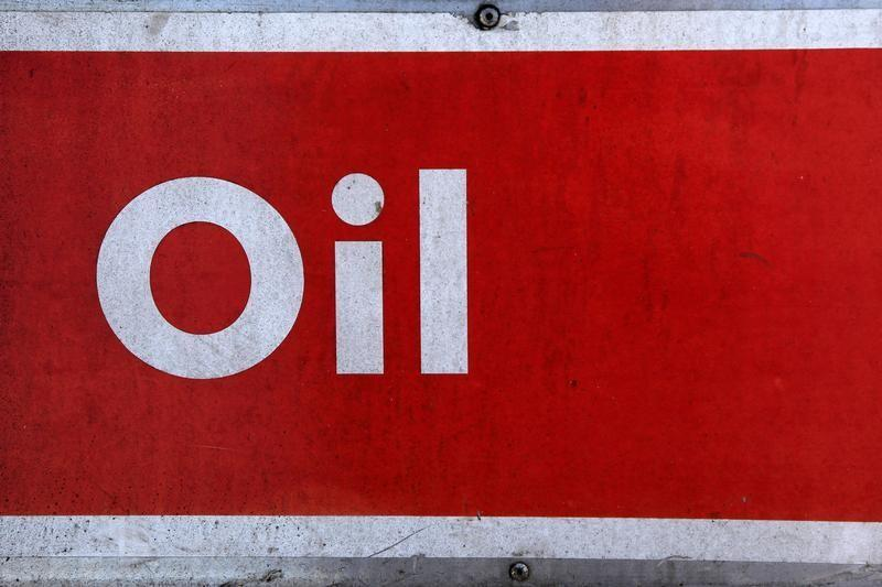 The word oil is pictured on an oil bank at a recycling yard in London March 2, 2011. REUTERS/Stefan Wermuth