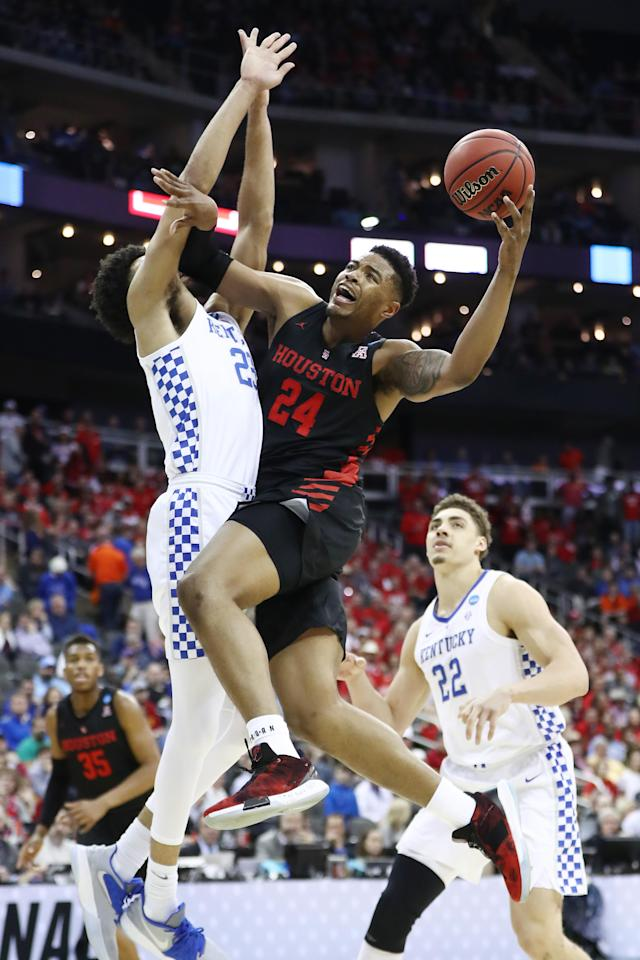 <p>Breaon Brady #24 of the Houston Cougars drives to the basket against EJ Montgomery #23 of the Kentucky Wildcats during the 2019 NCAA Basketball Tournament Midwest Regional at Sprint Center on March 29, 2019 in Kansas City, Missouri. (Photo by Jamie Squire/Getty Images) </p>