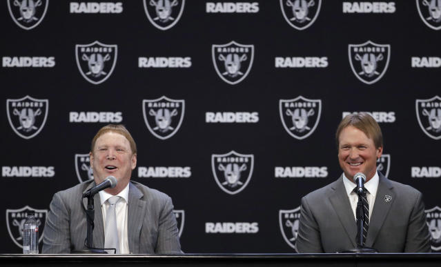 Oakland Raiders head coach Jon Gruden, right, and owner Mark Davis answer questions when Gruden was announced as coach. (AP)