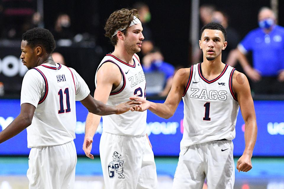 LAS VEGAS, NV - MARCH 09: Gonzaga forward Joel Ayayi (11) celebrates with Gonzaga guard Jalen Suggs (1) and Gonzaga forward Corey Kispert (24) during the championship game of the men's West Coast Conference basketball tournament between the BYU Cougars and the Gonzaga Bulldogs on March 9, 2021, at the Orleans Arena in Las Vegas, NV. (Photo by Brian Rothmuller/Icon Sportswire via Getty Images)