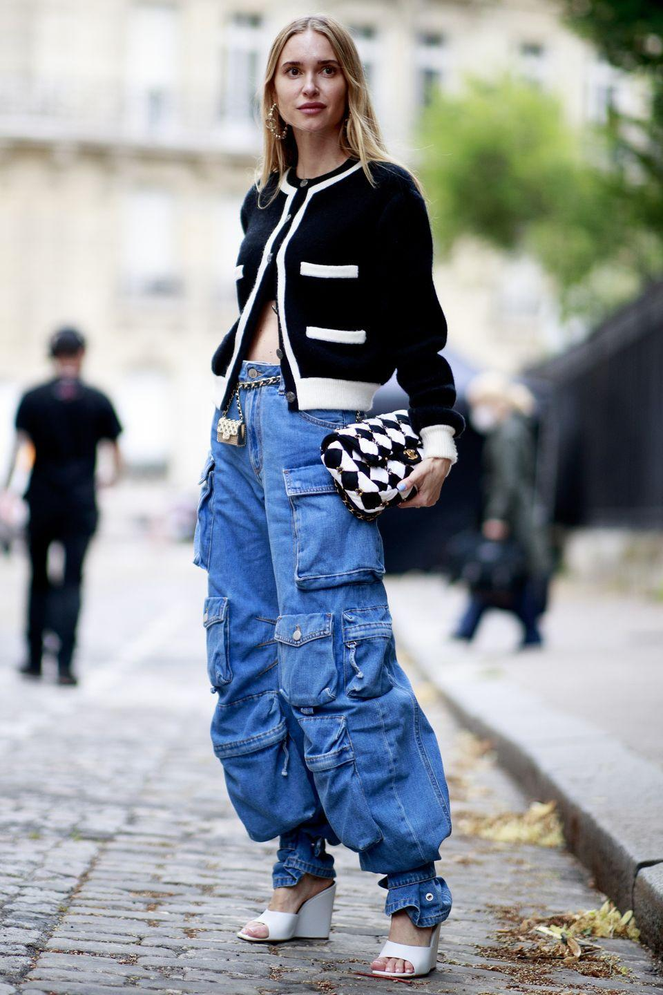 <p>Take style cues from Pernille Teisbaek who was pictured outside the Chanel couture show experimenting with different aesthetics in one look. Her playful mix of a smart Chanel jacket and casual baggy jeans is the perfect balance of tailored meets cool. </p>