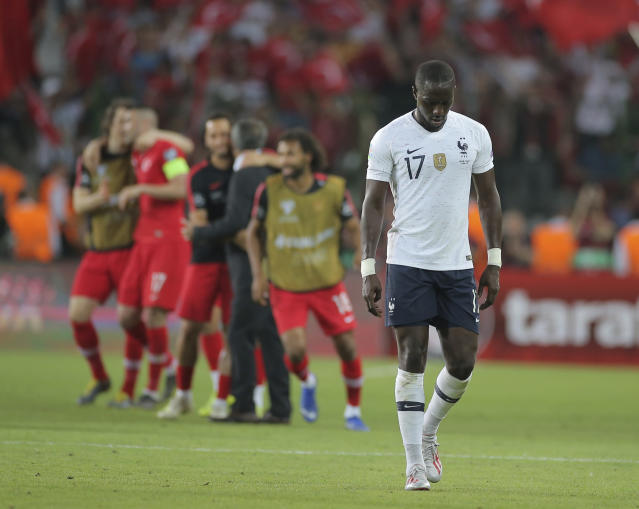 France's midfielder Moussa Sissoko walks from the pitch after the Euro 2020 Group H qualifying soccer match between Turkey and France in Konya, Turkey, Saturday June 8, 2019. Turkey won the match 2-0. (AP Photo)