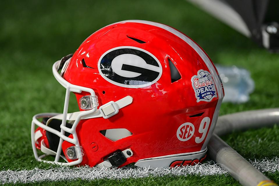 ATLANTA GA 01 JANUARY: Georgia football helmet under the Chick-fil-A peach bowl between the Cincinnati Bearcats and Georgia Bulldogs on January 1, 2021 at Mercedes-Benz Stadium in Atlanta, GA.  (Photo by Rich von Biberstein / Icon Sportswire via Getty Images)