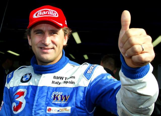 FILE PHOTO: Italian BMW 320i racing car driver Zanardi gives a thumbs up