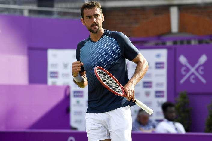 Marin Cilic of Croatia celebrates a point against Fabio Fognini of Italy during their singles tennis match at the Queen's Club tournament in London, Wednesday, June 16, 2021.(AP Photo/Alberto Pezzali)