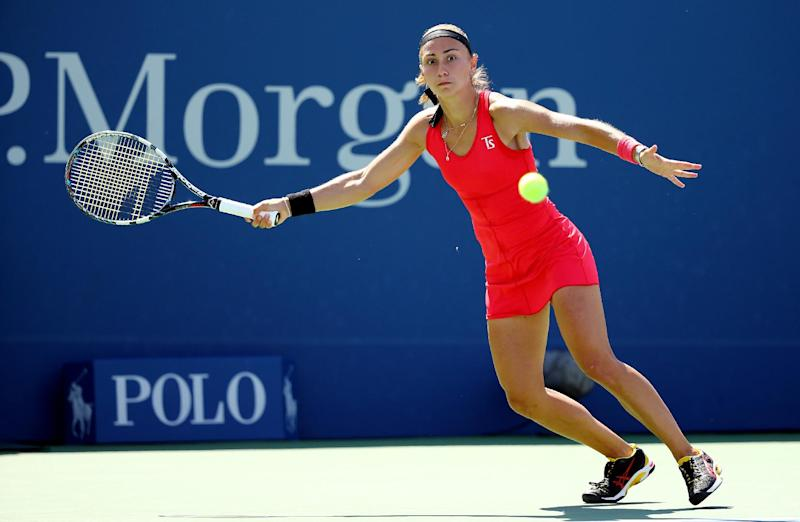 Aleksandra Krunic of Serbia returns a shot against Petra Kvitova of the Czech Republic during their women's singles third round match at the 2014 US Open on August 30, 2014 in New York (AFP Photo/Al Bello)
