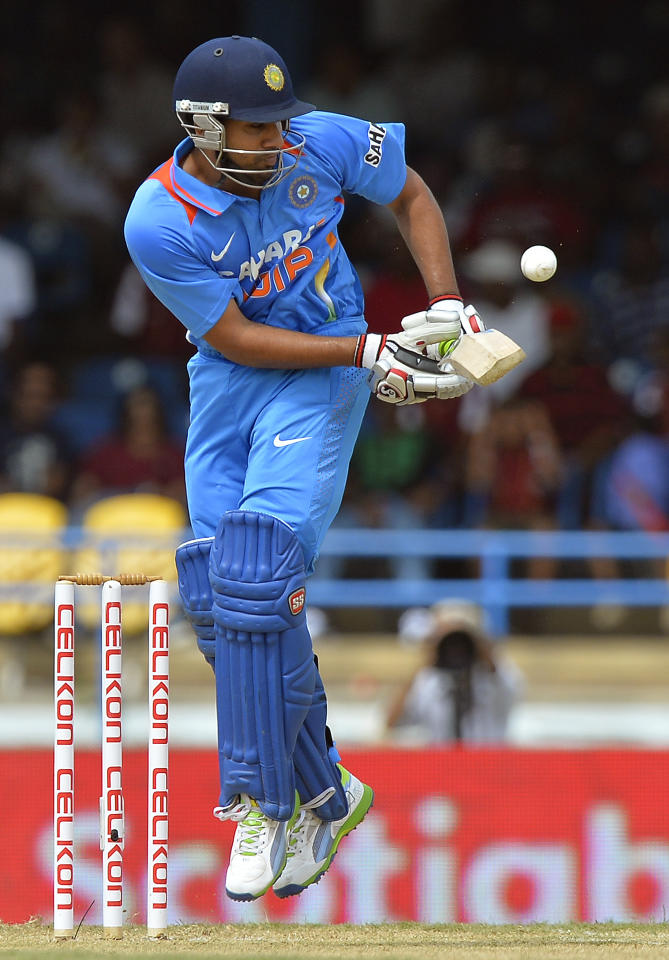 Indian cricketer Rohit Sharma plays a shot during the fourth match of the Tri-Nation series between India and West Indies at the Queen's Park Oval in Port of Spain on July 5, 2013. West Indies won the toss and elected to field. AFP PHOTO/Jewel Samad        (Photo credit should read JEWEL SAMAD/AFP/Getty Images)