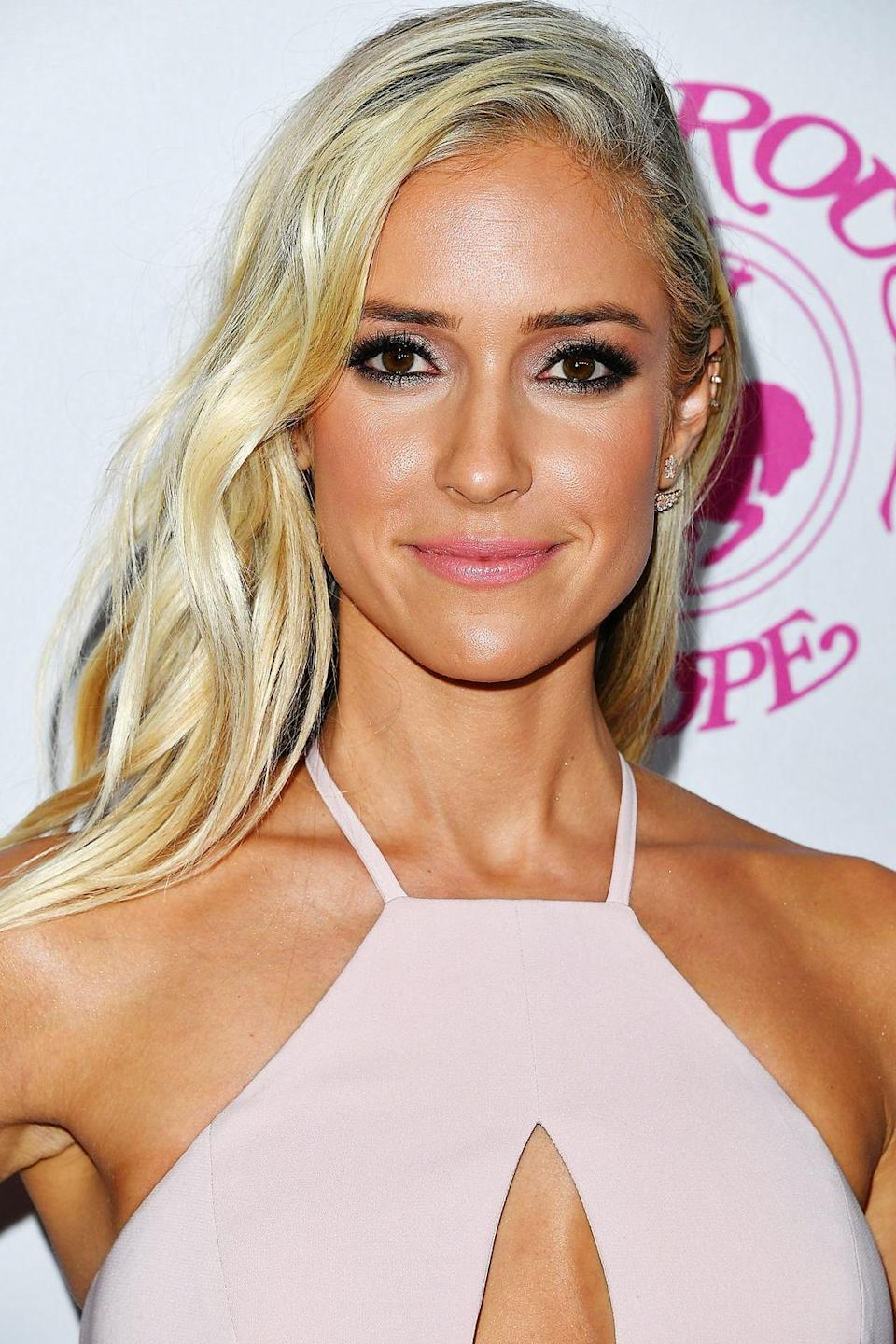 """<p><strong>Carousel Of Hope Ball, 2016</strong></p><p>""""This is one of my favourite <a href=""""http://www.refinery29.com/2016/10/126019/kristin-cavallari-platinum-blonde-hair"""" rel=""""nofollow noopener"""" target=""""_blank"""" data-ylk=""""slk:red carpet moments"""" class=""""link rapid-noclick-resp"""">red carpet moments</a>. Justin Anderson coloured my hair the day before, and going this blonde was not my intention. I don't know why it looked so light, but the next day it did <em>not</em> look that. Maybe it was because the colour was so fresh. Also, I must have done a fake tanner in this photo, because I look incredibly tan.</p><p>""""But I loved this dress. It's not often I get to go to an event and wear a gown, so it was really fun. This was just a night where everything came together. It was fun, I was out supporting juvenile diabetes. My husband has type 1 diabetes, so the cause is near and dear to my heart. So all around, great night.""""</p><span class=""""copyright"""">Photo: Steve Granitz/WireImage.</span>"""
