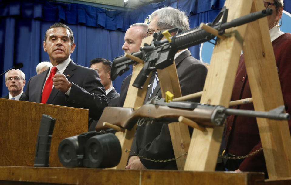 Los Angeles Mayor Antonio Villaraigosa, left, glances over to a pair of semi-automatic rifles as he discusses his support for a package of proposed gun control legislation at a Capitol news conference in Sacramento, Calif., Thursday, Feb. 7, 2013. Senate Democrats unveiled a package of 10 proposed laws designed to close loopholes in existing gun regulations, keep firearms and ammunition out of the hands of dangerous person and strengthen education relating to firearms and gun ownership.(AP Photo/Rich Pedroncelli)