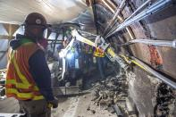 This May 19, 2019 photo provided by the Metropolitan Transportation Authority shows workers during the L Project subway tunnel rehabilitation, in New York. Eight years ago Thursday, Oct. 29, 2020, Superstorm Sandy pushed the Hudson River over its banks, sending 8 feet of water onto underground tracks and leaving the main waiting room unusable for months. New York's Metropolitan Transportation Authority, which serves several million riders daily on subways, trains and buses, had to repair damage to more than a dozen bridges and tunnels, many pre-dating World War II, caused by tens of millions of gallons of saltwater. (Trent Reeves/Metropolitan Transportation Authority via AP)