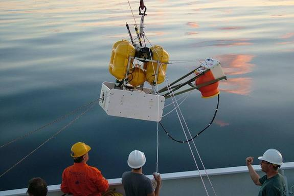 Scientists on a research vessel lower an ocean-bottom seismometer into the Mediterranean Sea, beginning a yearlong hunt for seismic activity on the seafloor.