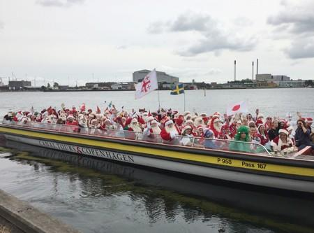 People dressed as Santa Claus take part in the World Santa Claus Congress in Copenhagen