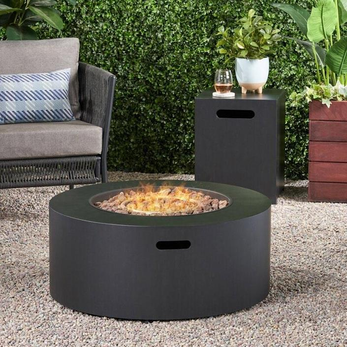 """Simple and streamlined, this fire pit is ideal for the <a href=""""https://www.architecturaldigest.com/gallery/minimalist-design-inspiration?mbid=synd_yahoo_rss"""" rel=""""nofollow noopener"""" target=""""_blank"""" data-ylk=""""slk:minimalist"""" class=""""link rapid-noclick-resp"""">minimalist</a>. Like many of the pits on this list, it's safe to put on your wooden deck—and, if you prefer, you can always add a heat-resistant mat under it for extra protection. $590, Wayfair. <a href=""""https://www.wayfair.com/outdoor/pdp/ebern-designs-estelle-iron-propane-fire-pit-w002662118.html"""" rel=""""nofollow noopener"""" target=""""_blank"""" data-ylk=""""slk:Get it now!"""" class=""""link rapid-noclick-resp"""">Get it now!</a>"""