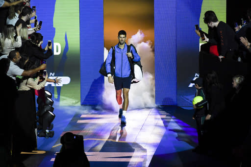 Novak Djokovic of Serbia enters the court prior to his match against Roger Federer of Switzerland during their ATP World Tour Finals singles tennis match at the O2 Arena in London, Thursday, Nov. 14, 2019. (AP Photo/Alberto Pezzali)