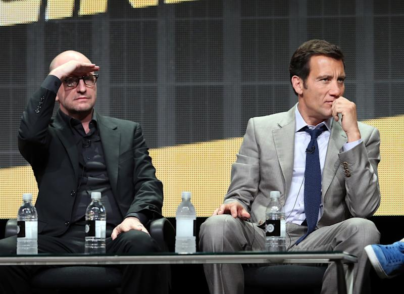 Director Steven Soderbergh (L) and actor Clive Owen speak onstage at the 'The Knick' panel during the HBO portion of the Summer Television Critics Association event, at The Beverly Hilton Hotel in Beverly Hills, California, on July 10, 2014 (AFP Photo/Frederick M. Brown)