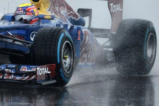 Red Bull Racing's Australian driver Mark Webber drives in the qualifying session at the Silverstone circuit on July 7 ahead of the British Formula One Grand Prix. Webber went on to win the race, while Silverstone's managing director has vowed to carry on in his job as the circuit started counting the cost of last weekend's rain-marred event