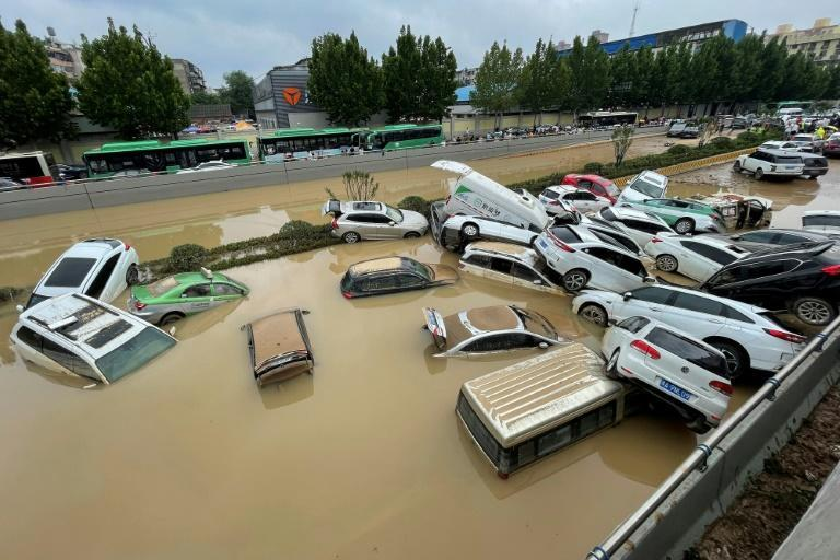 Residents were trapped in subway carriages, underground car parks, and tunnels as central China was hit by a year's worth of rain in three days.