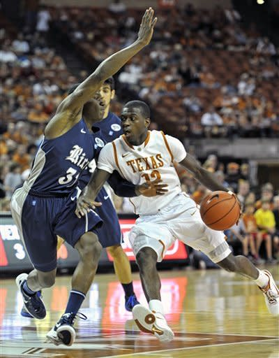 Texas guard Myck Kabongo, right, drives around Rice guard Dylan Ennis during the first half of an NCAA college basketball game Saturday, Dec. 31, 2011, in Austin, Texas. (AP Photo/Michael Thomas)