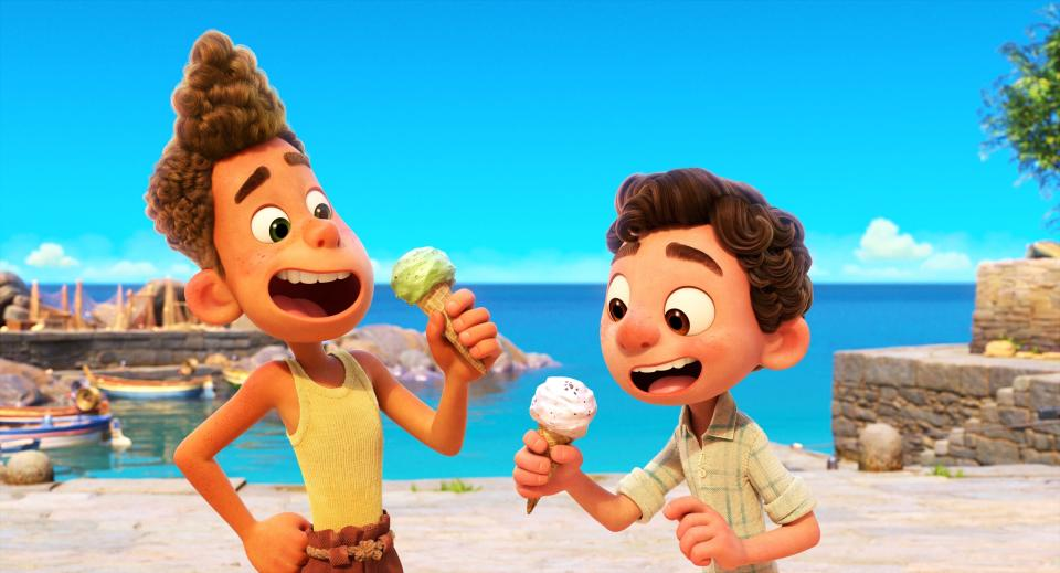 """This image released by Disney shows characters Alberto, voiced by Jack Dylan Grazer, left, and Luca, voiced by Jacob Tremblay in a scene from the animated film """"Luca."""" (Disney via AP)"""