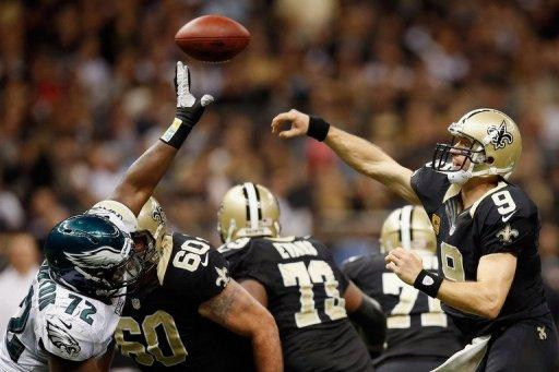 Drew Brees of the New Orleans Saints throws a pass over Cedric Thornton of the Philadelphia Eagles at Mercedes-Benz Superdome on November 5, in New Orleans, Louisiana. The Saints will rely on their on star quarterback Brees when the Atlanta Falcons, 8-0 for the first time in club history, will launch the second half of their campaign at NFC South division rivals New Orleans on Sunday