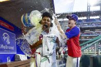 Philadelphia Phillies starting pitcher Ranger Suarez is doused in the dugout by teammates after a victory against the Pittsburgh Pirates, Saturday, Sept. 25, 2021, in Philadelphia. The Phillies won 3-0. (AP Photo/Derik Hamilton)