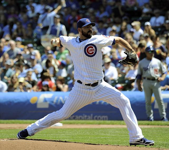 Chicago Cubs pitcher Carlos Villanueva throws a pitch in the first inning of a baseball game between the Chicago Cubs and the Los Angeles Dodgers Sunday Aug. 4, 2013 in Chicago, Ill. (AP photo/Joe Raymond)