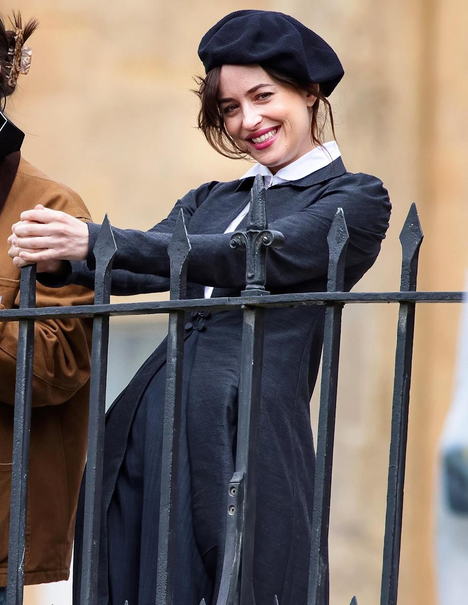 <p>Dakota Johnson gets into character for Netflix's adaptation of Jane Austen's classic book <em>Persuasion </em>on the Royal Crescent in Bath, England.</p>