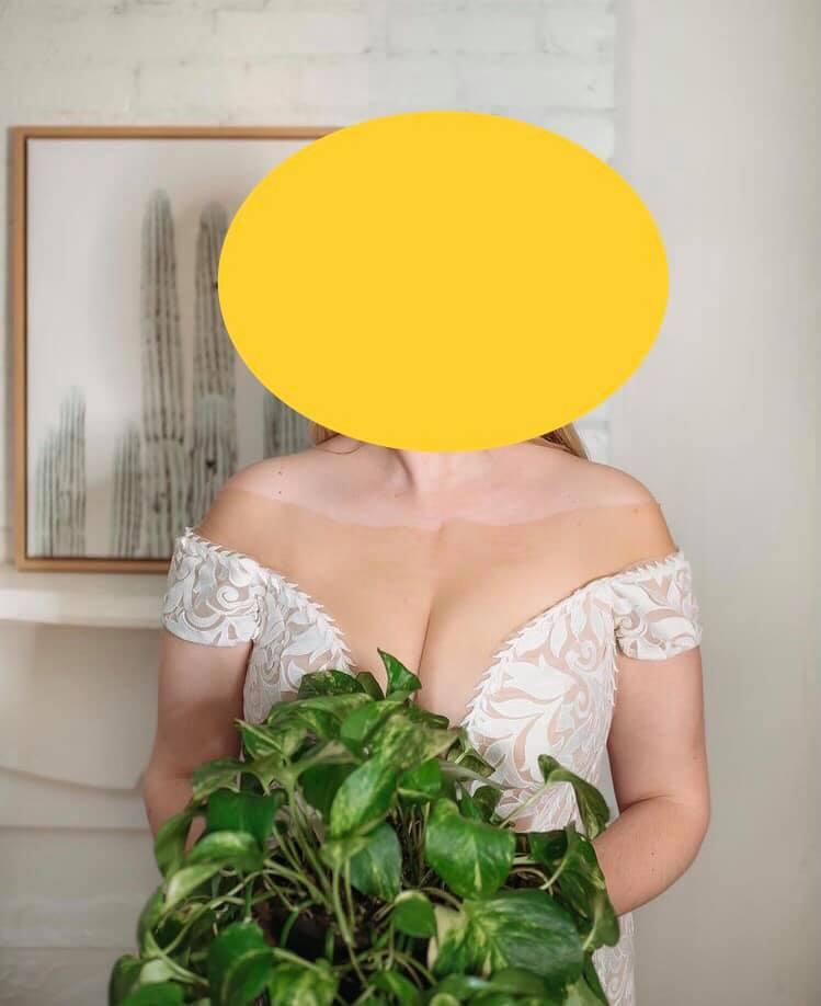 A bride's unusual choice in wedding dress has left many wondering if she had a 'fake tan fail'. Photo: Facebook.