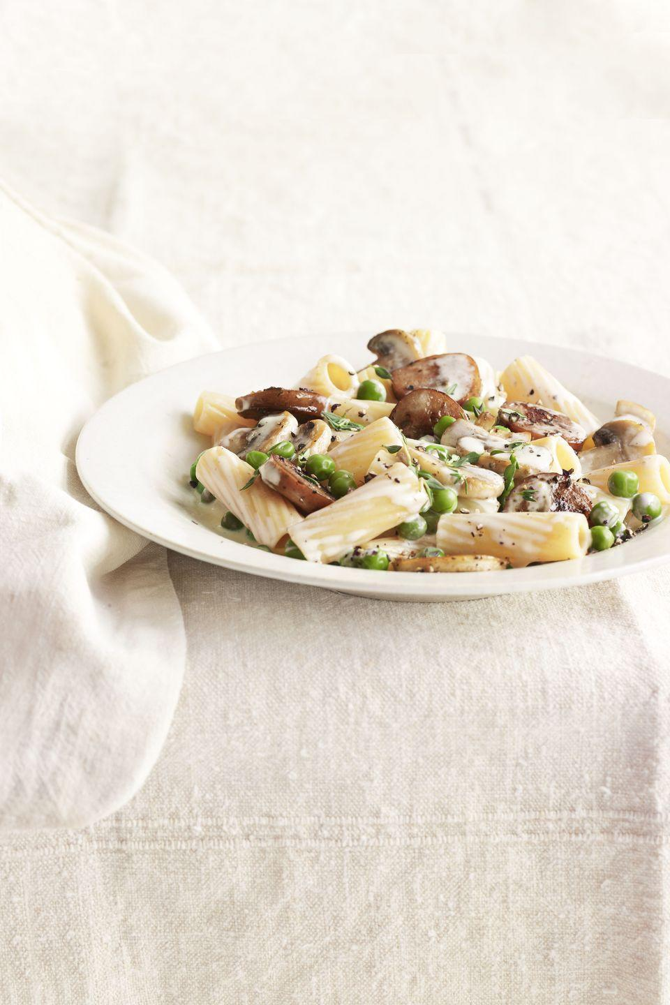 """<p>When it comes to pasta with cream sauce, you can't beat the trifecta of mushrooms, sausage, and peas. Even better? Lightening things up with a little white wine and thyme.</p><p><strong><a href=""""https://www.countryliving.com/food-drinks/recipes/a4105/rigatoni-sausage-peas-mushrooms-recipe-clv0512/"""" rel=""""nofollow noopener"""" target=""""_blank"""" data-ylk=""""slk:Get the recipe."""" class=""""link rapid-noclick-resp"""">Get the recipe.</a></strong></p>"""